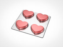 Medical care. Red heart shape pills on blister Stock Photo