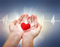 Medical and The cares concept, Red Heart in female hand Royalty Free Stock Photos