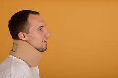 Medical cervical collar. Young man wearing medical cervical collar royalty free stock photography