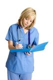 Medical Chart Nurse. Beautiful young medical chart nurse royalty free stock photo