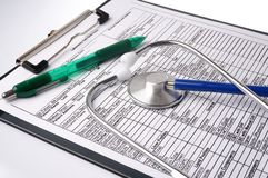 Medical chart and stethoscope Royalty Free Stock Photography