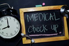 Medical Check up handwriting on chalkboard on top view. royalty free stock images