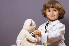 Medical check-ups. Four years old plays in doctor Royalty Free Stock Photo