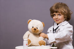 Medical check-ups. Four years old plays in doctor stock photography