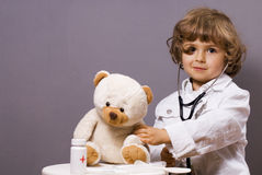 Medical check-ups. Four years old plays in doctor royalty free stock photos