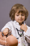 Medical check-ups. Four years old plays in doctor Royalty Free Stock Photography