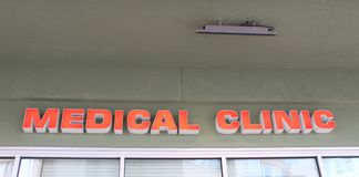 Medical clinic sign. Closeup of medical clinic sign on building over window stock photo