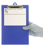 Medical clipboard with gloved hand Royalty Free Stock Image