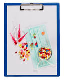 Medical clipboard, pills and ampoules Royalty Free Stock Images