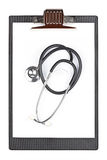 Medical clipboard with stethoscope Royalty Free Stock Photos