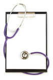 Medical clipboard and stethoscope Royalty Free Stock Photos
