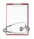 Medical clipboard with stethoscope as a background Stock Photos