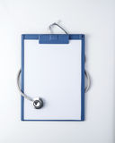 Medical clipboard and stethoscope Stock Images