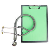 Medical clipboard and stethoscope isolated on white background. Stock Photo