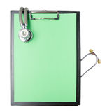 Medical clipboard and stethoscope isolated on white background. Concept of Healthcare And Medicine Stock Photos