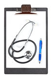 Medical clipboard with stethoscope and pen Royalty Free Stock Photo