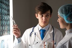 Medical colleagues confer near the x-ray image Stock Photos