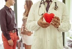 Medical concept about cardiology. doctor holding a plastic icon heart Stock Photos