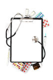 Medical concept : clipboard , stethoscope, pills and syringe Stock Images