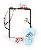 Medical concept : clipboard ,stethoscope, pills and syringe Royalty Free Stock Images