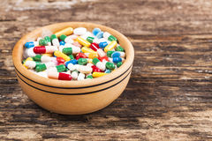 Medical concept the colorful medicine,pills,tablets,,bowl Royalty Free Stock Photo