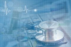 medical concept, double exposure of stethoscope on black keyboard stock photo
