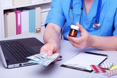 Medical concept - health price. dollars with assorted pills, cardiogram rx and stethoscope. Stock Images