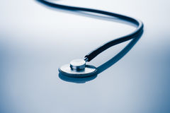Medical concept image. Stethoscope on blue background with copy space Stock Photos