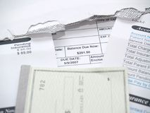 A medical bill and check book. A medical concept with a statement bill and checkbook Royalty Free Stock Photography