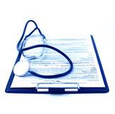 Medical concept : stethoscope and medical form on clipboard Stock Image