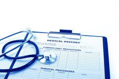 Medical concept : stethoscope and medical history form Stock Images