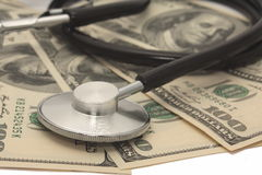 Medical concept - stethoscope over the dollar bills Royalty Free Stock Images
