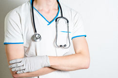 Medical personnel standing with crossed arms Royalty Free Stock Photo