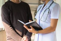 Medical. Concepts,Nurse record patient symptoms Stock Photos