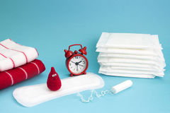 Medical conceptual photo. Red dreamy smile crochet blood drop, daily and menstrual pad and tampon. Woman critical days, gynecologi. Cal menstruation cycle royalty free stock photography