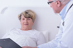 Medical consultation in hospital room Royalty Free Stock Image