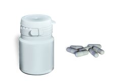 Medical container and capsules. Clean medical container and pharmaceutical capsules on a white background Stock Image