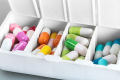 Medical container with the various pills Royalty Free Stock Photography