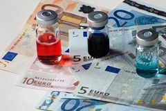 Medical containers and european banknotes. Suggestion on drug market evolution Royalty Free Stock Image
