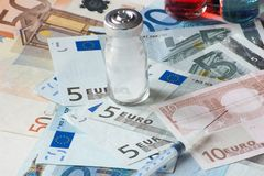 Medical containers and european banknotes and syringe. Suggestion on drug market evolution Royalty Free Stock Images
