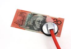 Medical costs. Stethoscope over 20 australian dollars banknote Stock Image