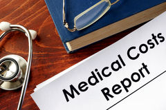 Medical Costs Report. On a table and book Stock Photo