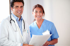 Medical couple smiling and looking at you Stock Image