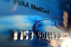 Medical (credit) Card. MediCard in Blue Stock Photography