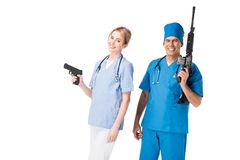 Medical crew nurse and doctor in uniform with guns royalty free stock images