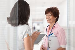 Medical crew talking on hospital corridor Royalty Free Stock Photography