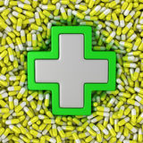 Medical cross. Sign on the yellow pills background Royalty Free Stock Images