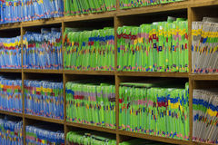 Medical or Dental patient files in medical or dental office. Large bookshelf filled with paper files of patients stock photography