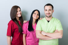 Medical or dental team. Standing and smiling with confidence stock photos
