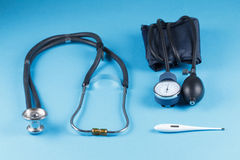 Medical devices stethoscope, tonometer, and thermometer Royalty Free Stock Photos